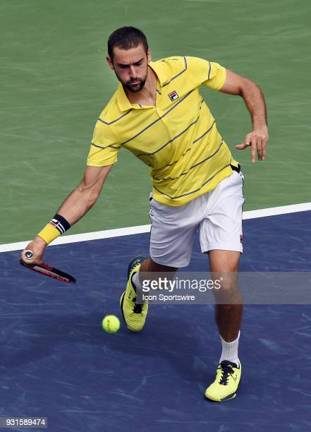 ATP tennis player Marin Cilic comes in for the ball during the second set of a match played at the BNP Paribas Open on March 13 2018 at the Indian...