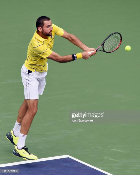 ATP tennis player Marin Cilic hits a backhand shot during the second set of a match played at the BNP Paribas Open on March 13 2018 at the Indian...