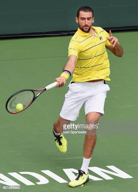 ATP tennis player Marin Cilic hits the ball during the second set of a match played at the BNP Paribas Open on March 13 2018 at the Indian Wells...