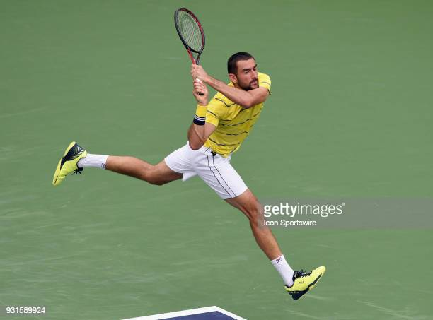 ATP tennis player Marin Cilic watches his shot during the second set of a match played at the BNP Paribas Open on March 13 2018 at the Indian Wells...