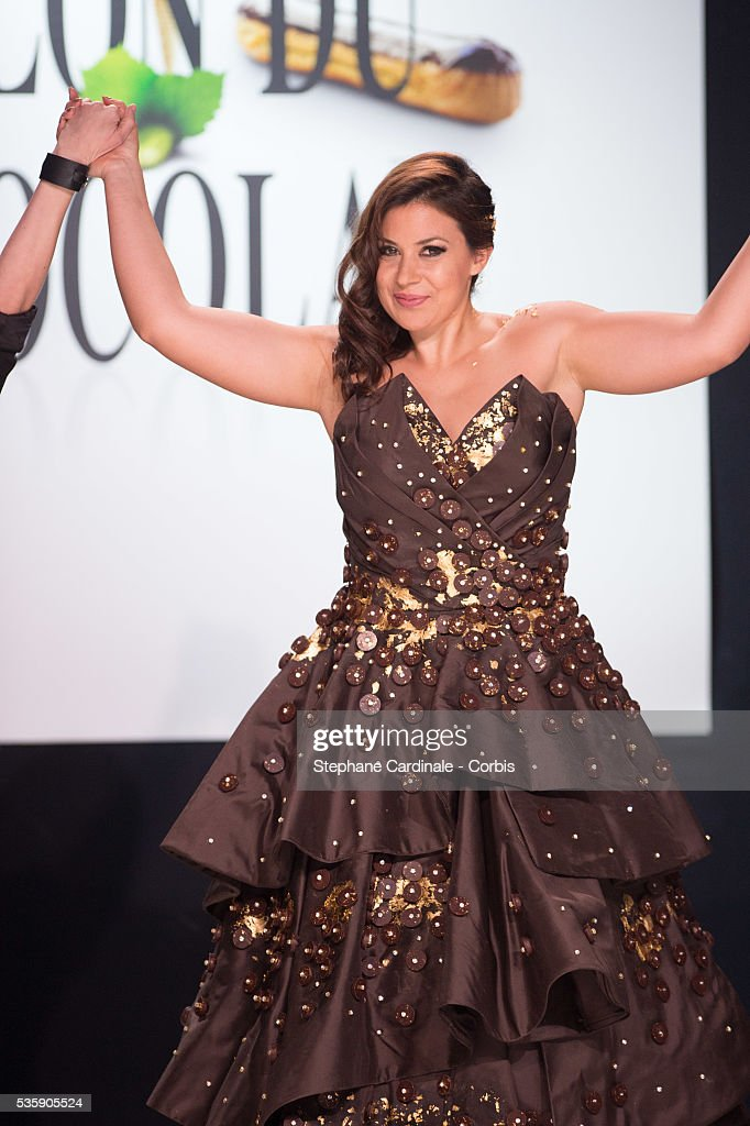 Tennis player Marion Bartoli walks the runway and wears 'Pluie d'Or' a chocolate dress made by designer Florencia Soerensen and chocolate maker Philippe Bernachon during the Fashion Chocolate Show at Salon du Chocolat at Portes de Versailles, in Paris.