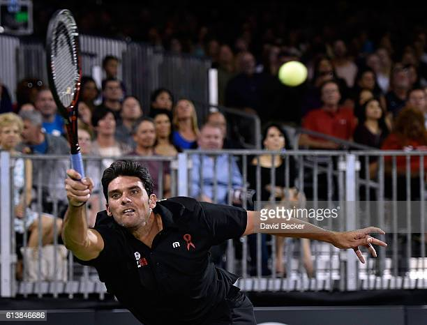 Tennis player Mark Philippoussis competes during the World TeamTennis Smash Hits charity tennis event benefiting the Elton John AIDS Foundation at...