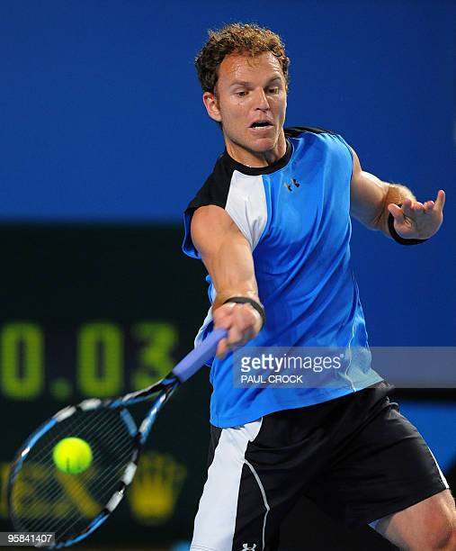 Tennis player Michael Russell plays a forehand return during his first round men's singles match against Argentinian opponent Juan Martin Del Potro...