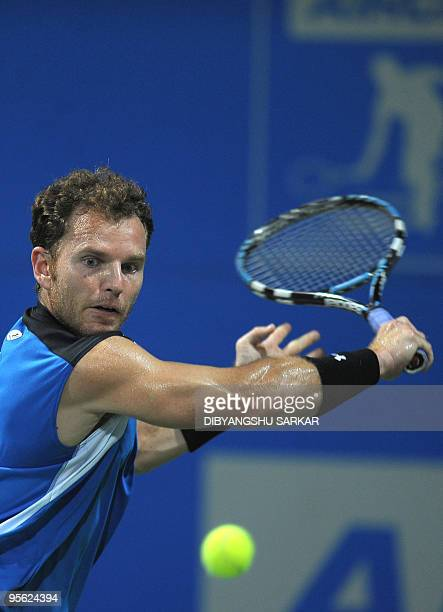 Tennis player Michael Russell plays a return shot against his Swiss opponent Stanislas Wawrinka during their second round match at the ATP Chennai...