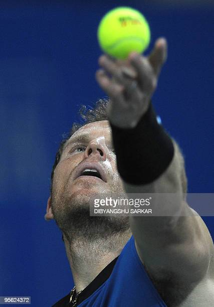 Tennis player Michael Russell prepares to serve against his Swiss opponent Stanislas Wawrinka during their second round match at the ATP Chennai Open...