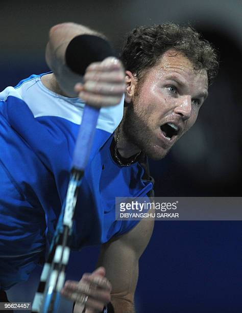 Tennis player Michael Russell serves against his Swiss opponent Stanislas Wawrinka, during their second round match at the ATP Chennai Open 2010, in...