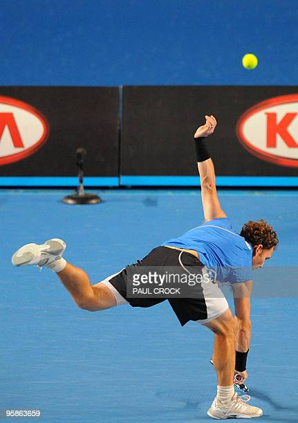 Tennis player Michael Russell stretches for the ball during his men's singles match against Argentinian opponent Juan Martin Del Potro on the first...