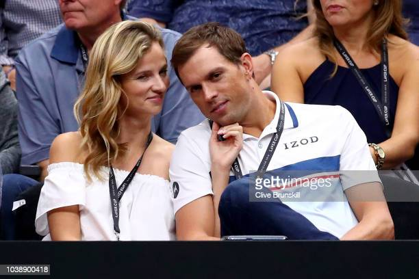Tennis player Mike Bryan of the United States and model Nadia Murgasova of Slovakia watch the Men's Singles match between Team Europe Alexander...