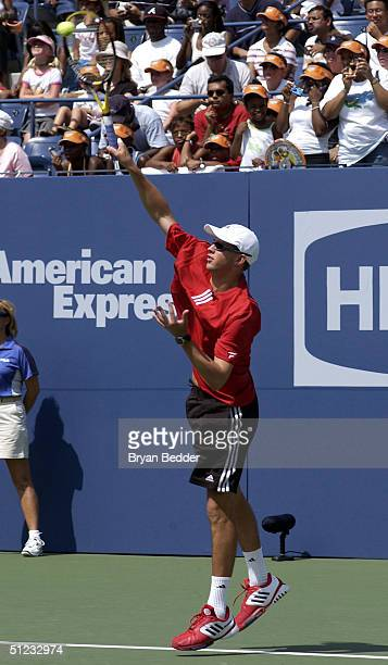 Tennis player Mike Bryan plays a game to raise money for chairty during Arthur Ashe day at the US Open August 28 2004 in New York City