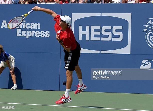 Tennis player Mike Bryan plays a game to raise money for charity during Arthur Ashe day at the US Open August 28 2004 in New York City