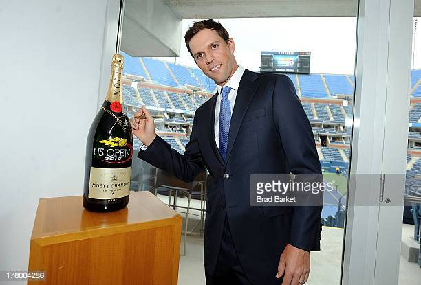 Tennis Player Mike Bryan signs a Moet Chandon Jeroboam at the 13th Annual USTA Serves Opening Night Gala at the US Open on August 26 2013 in New York...