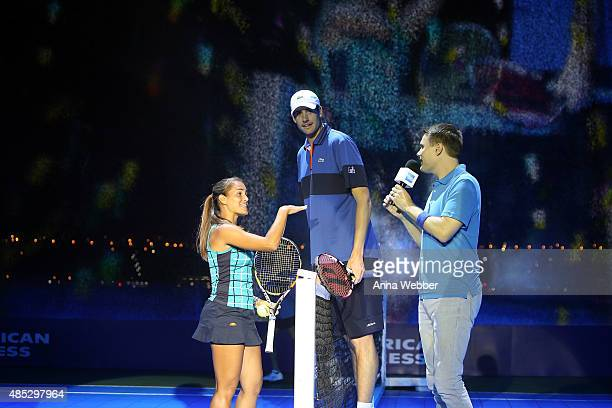 Tennis player Monica Puig and tennis player John Isner attend Rally On The River presented by American Express featuring Maria Sharapova John Isner...