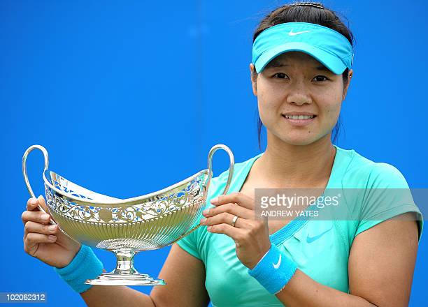 Tennis player Na Li of China holds the Maud Watson trophy after beating Maria Sharapova of Russia 75 61 in the final of the AEGON Classic tennis...