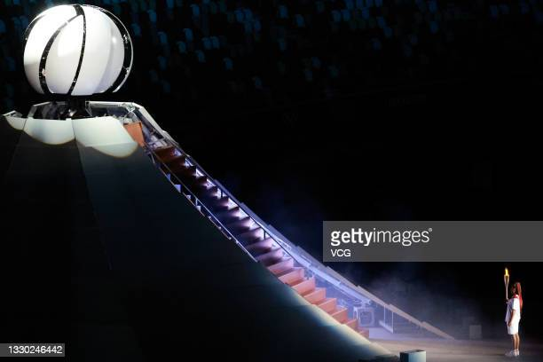 Tennis player Naomi Osaka carries the Olympic torch during the Opening Ceremony of the Tokyo 2020 Olympic Games at Olympic Stadium on July 23, 2021...