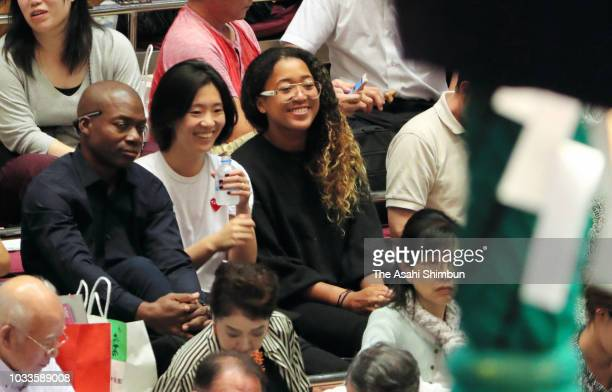 Tennis player Naomi Osaka watches sumo bouts on day seven of the Grand Sumo Autumn Tournament at Ryogoku Kokugikan on September 15 2018 in Tokyo Japan