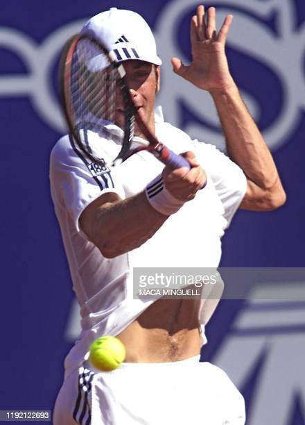 Tennis player Nicolas Massu of Chile hits the ball during his match against Nicolas Lapentti at the Vina del Mar Chile 16 February 2002 during the...