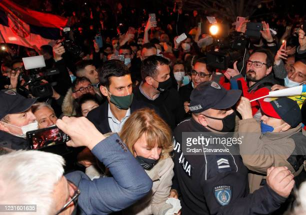 Tennis player Novak Djokovic accompanied by his parents celebrates 311 weeks as world number one with his family and supporters in front of family...