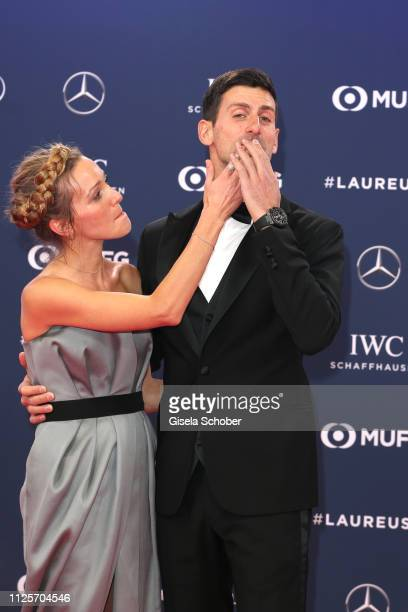 Tennis player Novak Djokovic and his wife Jelena Ristic remove lipstick after a kiss during the Laureus World Sports Awards 2019 at Sporting Club on...
