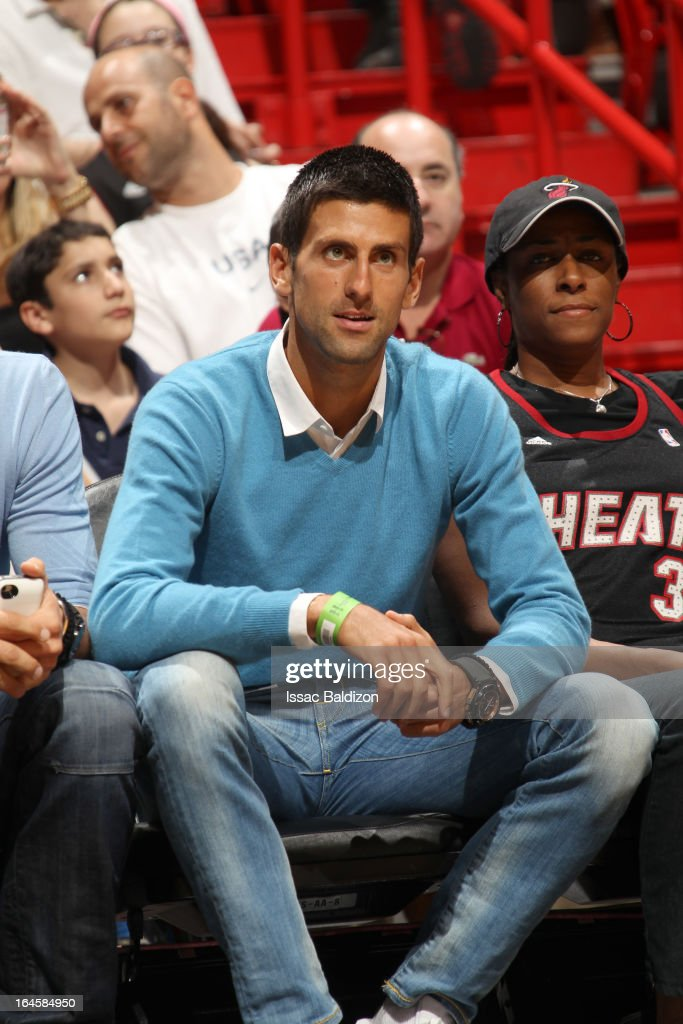 Tennis player Novak Djokovic attends a game between the Charlotte Bobcats and the Miami Heat on March 24, 2013 at American Airlines Arena in Miami, Florida.