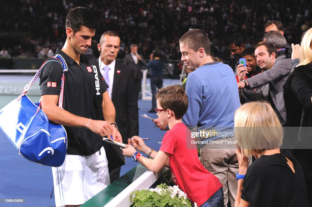 Tennis player Novak Djokovic of Serbia signs autographs after the match against Roger Federer during day six of the BNP Paribas Tennis Masters, held at Bercy on November 2, 2013 in Paris, France.