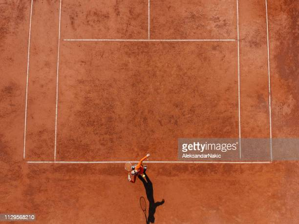 tennis player on a tennis court during the match - tennis player stock pictures, royalty-free photos & images