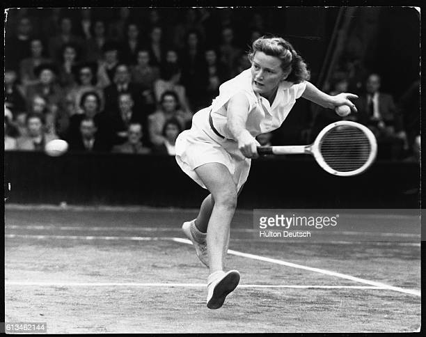 Tennis player Pauline Betz swings at the ball during a match at the 1946 Wimbledon Championship