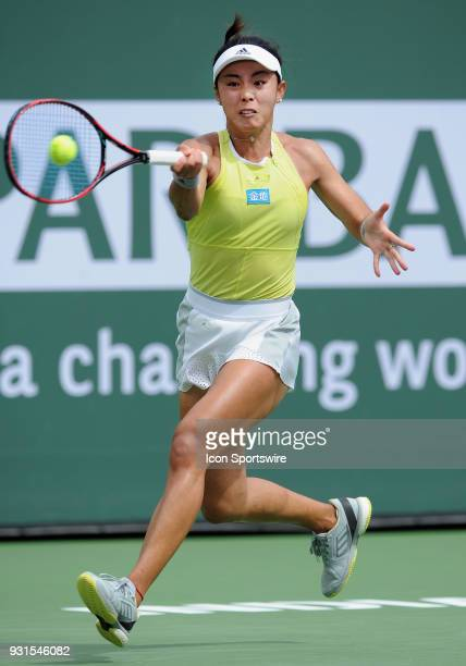 WTA tennis player Qiang Wang chases after the ball in the second set of a match played at the BNP Paribas Open on March 13 2018 at the Indian Wells...