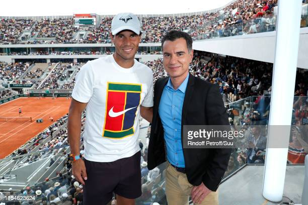 """Tennis player Rafael Nadal and journalist Laurent Luyat pose at """"France Televisions"""" french chanel studio during the 2019 French Tennis Open - Day..."""