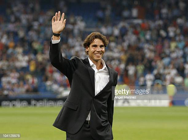 Tennis player Rafael Nadal greets prior to the start of the UEFA Champions League group G match between Real Madrid and AFC Ajax at Estadio Santiago...
