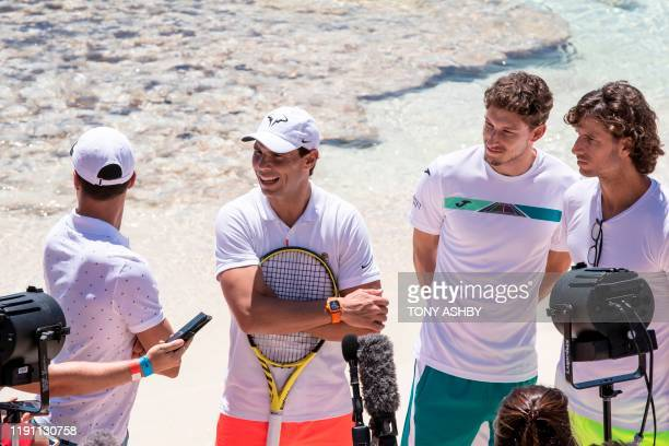 Tennis player Rafael Nadal of Spain with teammates Roberto Bautista Agut Pablo Carreno Busta and Feliciano Lopez speak to the media during a visit to...