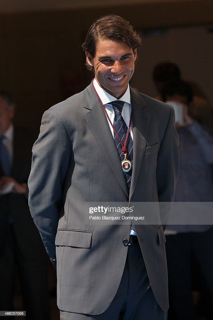 Tennis player Rafael Nadal poses after being awarded as honorary citizen of the city of Madrid in the Cibeles Palace on May 5, 2014 in Madrid, Spain.