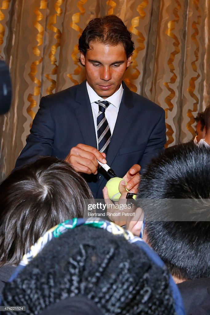 Tennis player Rafael Nadal signs autographs after Mayor of Paris Anne Hidalgo Awarded the 'Grand Vermeil' Medal to him at Mairie de Paris on May 21, 2015 in Paris, France.