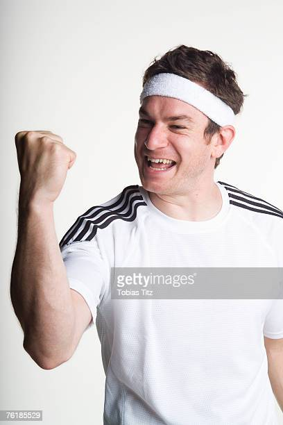A tennis player raising his fist in celebration