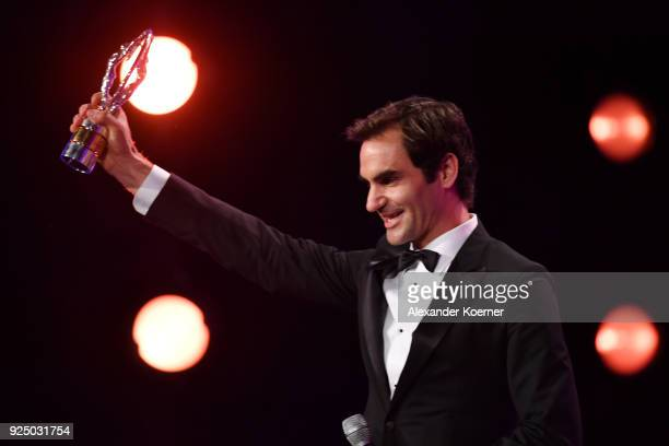 Tennis player Roger Federer accepts the Laureus World Comeback of the Year during the 2018 Laureus World Sports Awards show at Salle des Etoiles...