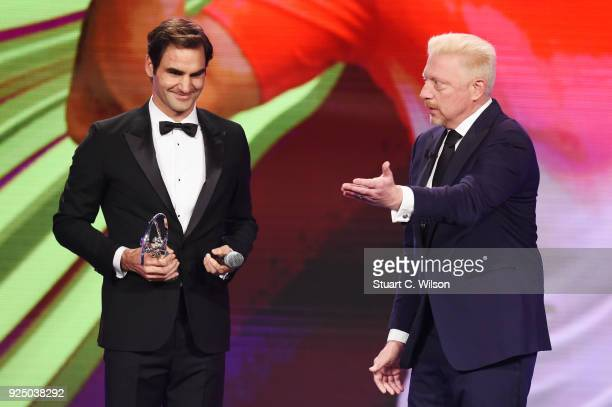 Tennis player Roger Federer accepts the Laureus World Comeback of the Year from Laureus Academy member Boris Becker during the 2018 Laureus World...