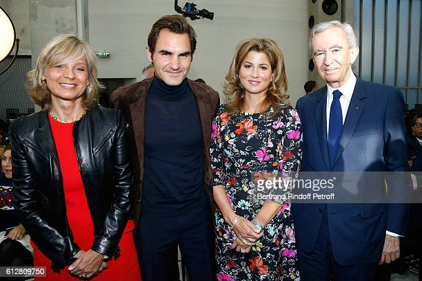 Tennis player Roger Federer and his wife Mirka Federer standing between Owner of LVMH Luxury Group Bernard Arnault and his wife Helene attend the...