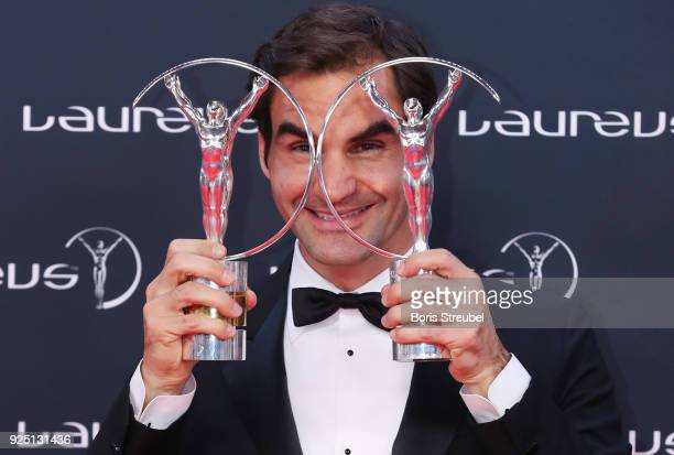 Tennis player Roger Federer holds his awards for Laureus World Comeback of the Year 2018 and Laureus World Sportsman of the Year 2018 during the...