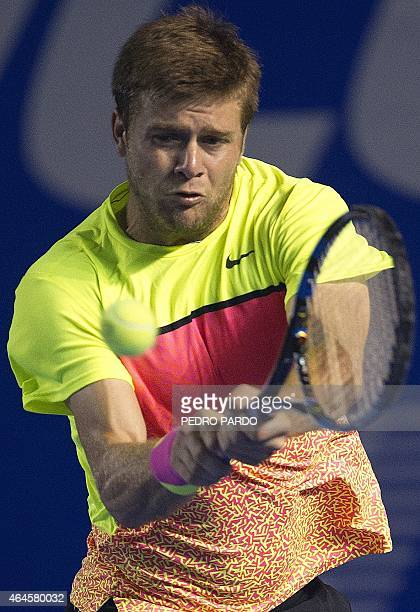 US tennis player Ryan Harrison returns the ball to Croatia's Ivo Karlovic during their Mexico ATP tournament in Acapulco Guerrero State on February...