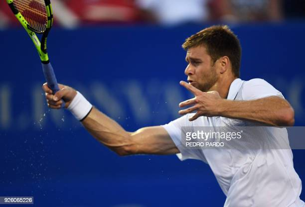 US tennis player Ryan Harrison returns the ball to Germany's Alexander Zverev during their Mexico ATP 500 Open men's single tennis match in Acapulco...