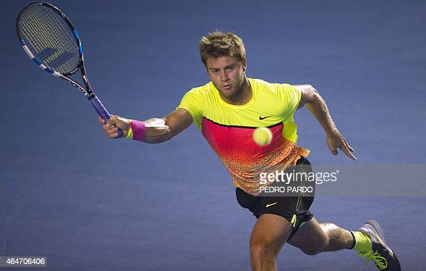 US tennis player Ryan Harrison returns the ball to Spain's David Ferrer during their Mexico ATP Open men's singles semifinal tennis match in Acapulco...