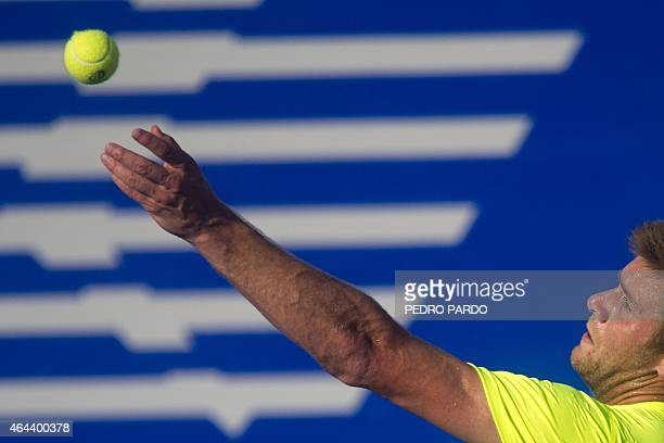 US tennis player Ryan Harrison serves to Bulgaria's Grigor Dimitrov during the Mexico ATP tournament in Acapulco Guerrero State on February 25 2015...