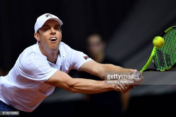 US tennis player Sam Querrey returns the ball to Serbia's Laslo Djere during the Davis Cup World Group first round single match between Serbia and...