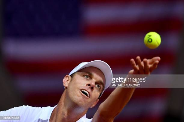 US tennis player Sam Querrey serves the ball to Serbia's Laslo Djere during the Davis Cup World Group first round single match between Serbia and USA...