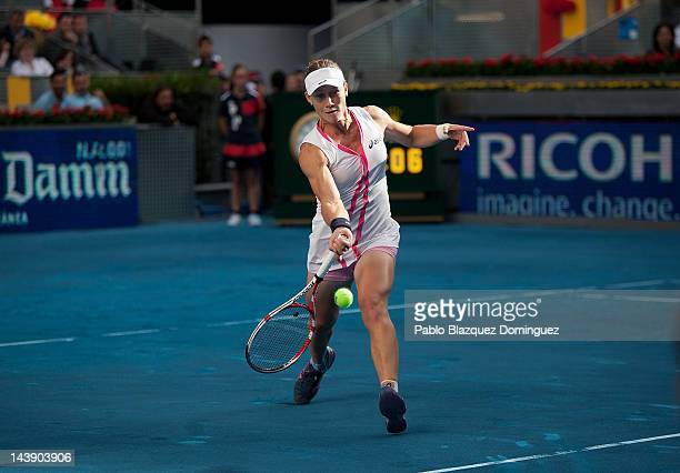 Tennis player Samantha Stosur of Austria returns the ball to Petra Martic of Croathia during the first day of the WTA Mutua Madrilena Madrid Open...