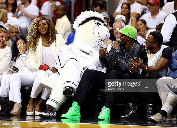 Tennis player Serena Williams and runner Usain Bolt meet with Miami Heat mascot Burnie during Game Four of the 2014 NBA Finals between the Miami Heat...