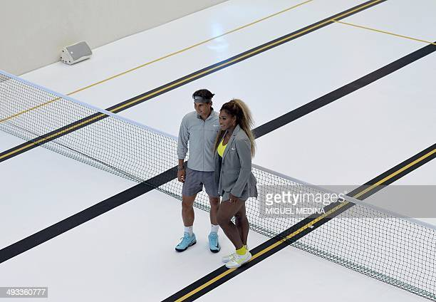 US tennis player Serena Williams and Spanish tennis player Rafael Nadal pose as they arrive to play tennis with children on a tennis court set up in...