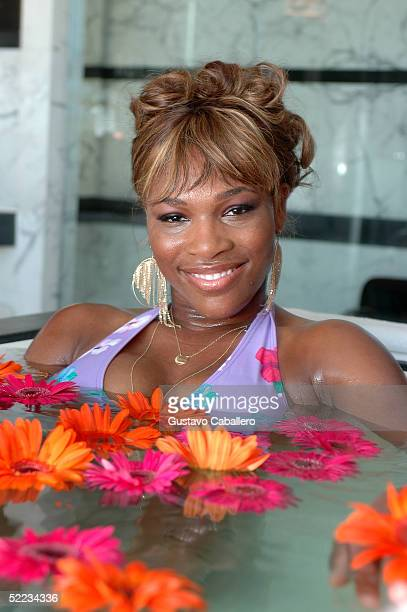 Tennis player Serena Williams christens the $5000 Evian bath in the Presidential Suite at the Hotel Victor on February 23 2005 in Miami Beach Florida