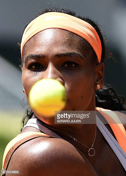 Tennis player Serena Williams looks at the ball prior to returning it to Spanish tennis player Carla Suarez Navarro during the Madrid Open tournament...