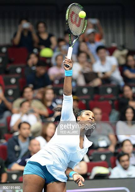 US tennis player Serena Williams of Philippine Mavericks serves against Serbian Ana Ivanovic of UAE Royals in the women's singles of the...