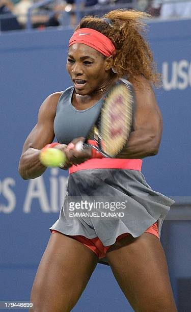 US tennis player Serena Williams plays a points against Spain's Carla Suarez Navarro during their 2013 US Open women's singles match at the USTA...